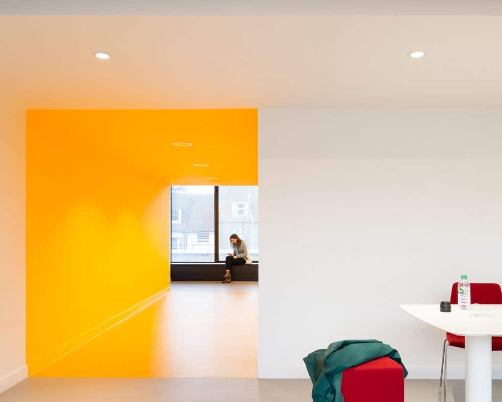 architecture yellow. vibrantly coloured stairs and circulation lobbies displaying historical photographic instruments prints bringing together learning art culture architecture yellow p